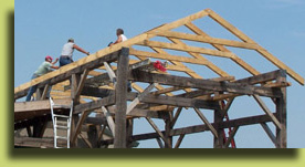 Click to view larger photo of building the roof