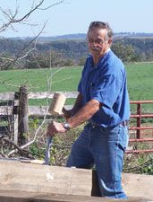 Click to view larger photo of Duane using the mallot and chisel