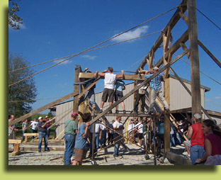 Click to view larger photo the group lifting the timber-framed wall